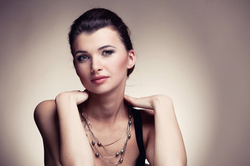 Portrait of luxury woman in exclusive jewelry