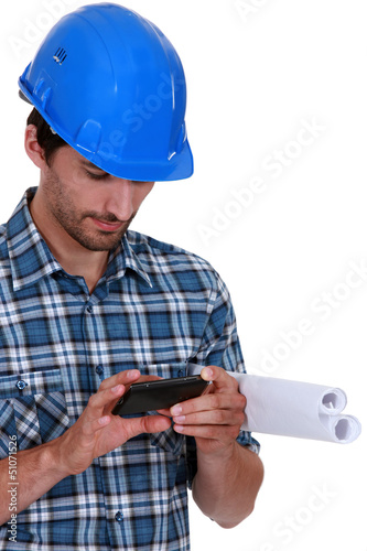 Architect sending text message