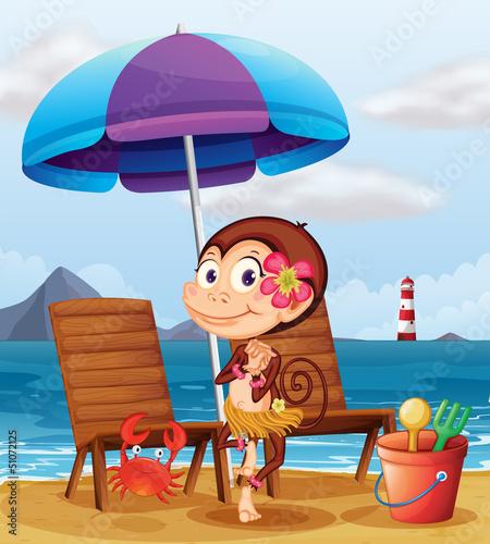 A monkey in a hawaiian attire at the beach