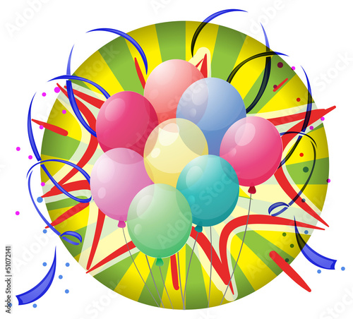 A spinning wheel with balloons and confetti