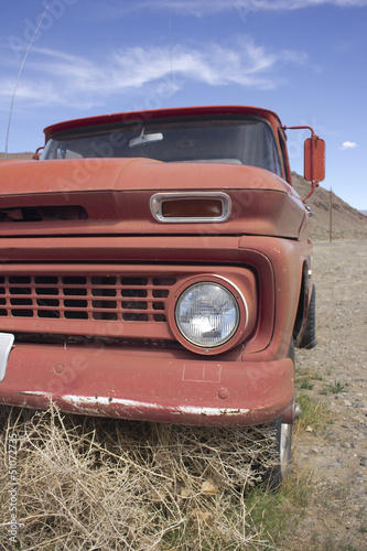 Old rusty truck in the desert with blue skies
