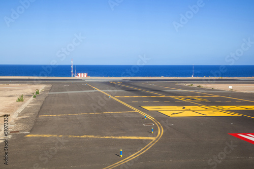 runway with ocean in the background - 51073332