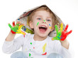 Cute little boy with coloured hands cheers for fun