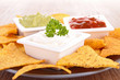 nachos and assortment of dips
