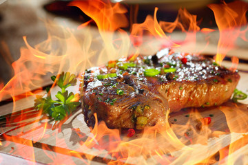 grilled steak with flames