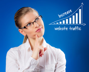 Beautiful blond female thinking about website traffic increase
