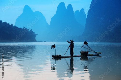 Chinese man fishing with cormorants birds, Yangshuo, Guangxi reg