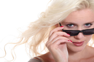 Attractive blond woman wearing sunglasses in studio