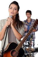 brunette with microphone rehearsing