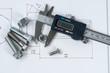 Leinwandbild Motiv Vernier caliper and assorted screw, nuts and bolts