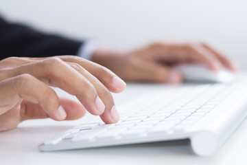 Business hands typing on keyboard in office