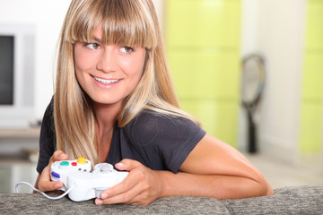 blonde woman playing video games