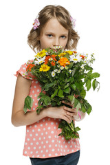 Little girl holding bunch of wildflowers over white background