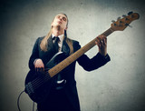 artist playing bass