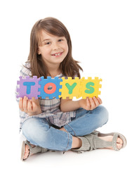 Cute girl with toys