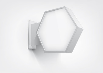 Blank, hexagon shop sign hanging on a wall