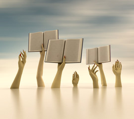 arms holding books on horizontal blur background