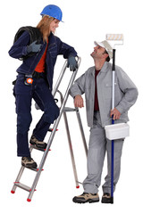 Electrician and painter standing together