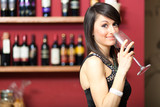 Woman toasting red wine in a restaurant