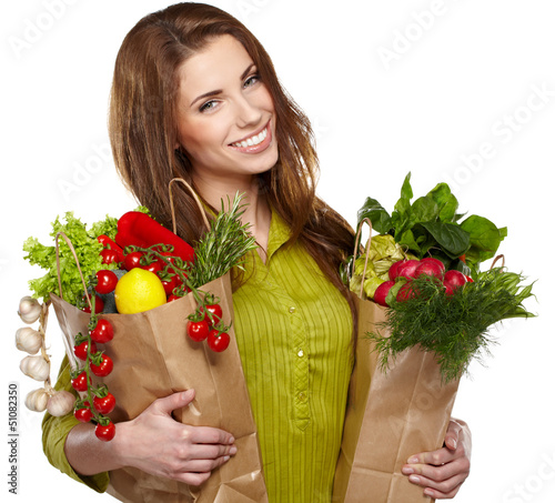 Portrait of happy young female holding a shopping bag full of gr