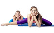 Two beautiful young woman doing stretching exercise