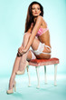 Woman in lingerie posing on a stool