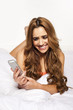 Woman laughing as she reads a text message