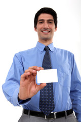 businessman with toothy smile showing business card