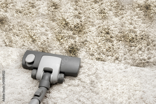 Vacuuming dirty carpet