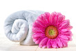 Spa background with towel and gerbera