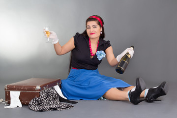 funny pinup girl drinking champagne