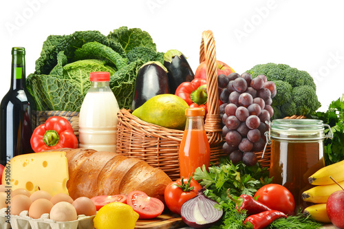 Groceries in wicker basket including vegetables and fruits - 51086772