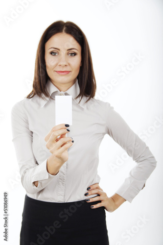 Beautiful business woman holding a blank card in her hand.
