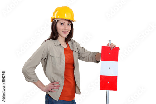 Brunette stood with warning sign
