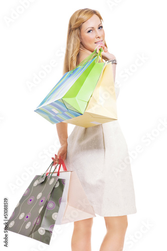 Portrait of an attractive young female holding shopping bags
