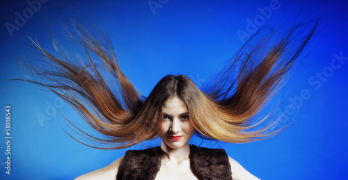Fashion model with hair blowing in the wind