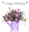 beautiful bouquet of purple flowers in watering can isolated
