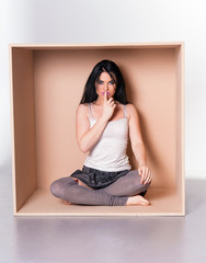 Model asks for silence - trapped in box concept