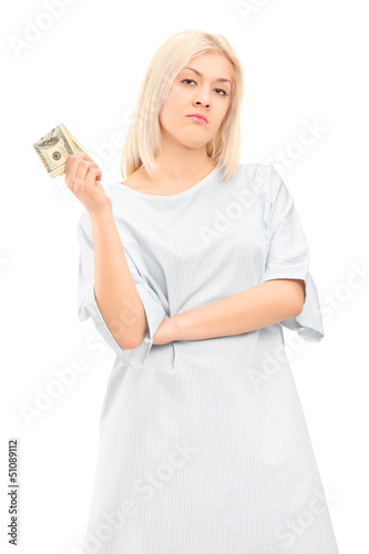 Female patient in a gown holding money