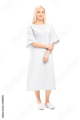 Full length portrait of a female patient posing in a hospital go