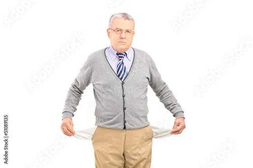 Senior man with empty pockets