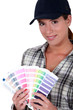 Painter holding a spectrum of colour samples