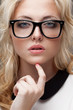 portrait of blonde woman wearing eyeglasses