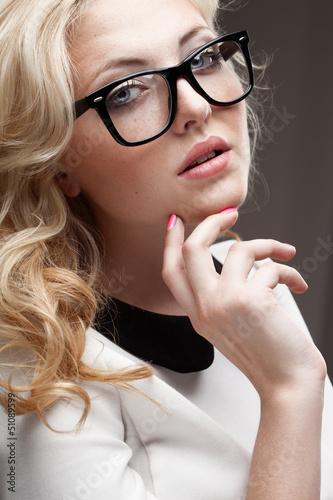 portrait of blonde woman wearing eyeglasses
