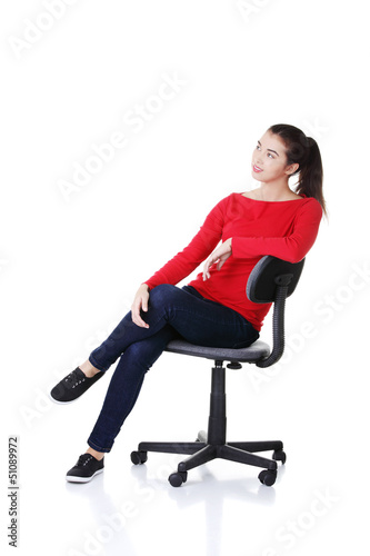 Young happy woman sitting on a wheel chair
