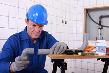 craftsman assembling pipes