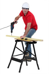 Carpenter using cordless drill
