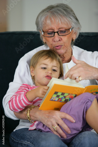 Grandma and child reading together