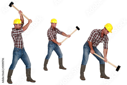 Tradesman laboriously using a mallet