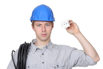 Electrician holding a plug socket